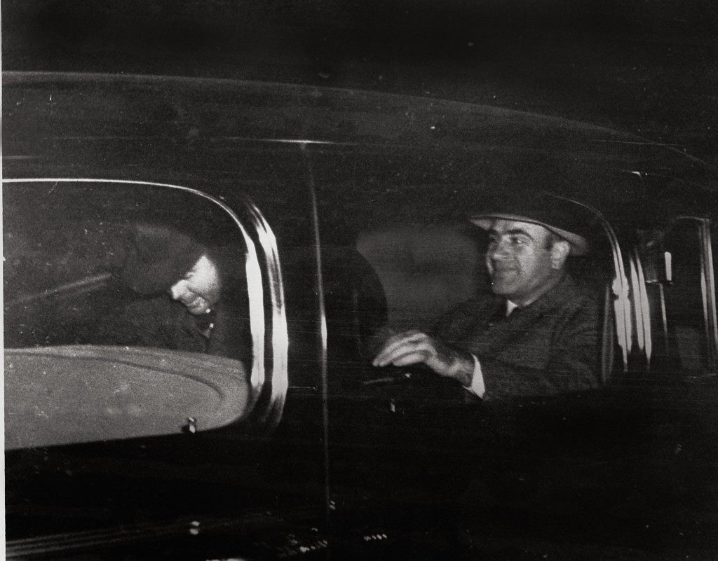 Al Capone, right, Chicago's infamous gang overlord during prohibition, leaves Harrisburg, Pa., on Nov. 16, 1939 with a federal officer for Lewisburg, Pa., where he was released after spending seven years in prison in Atlanta and San Francisco's Alcatraz. (AP Photo) Ref #: PA.8683302  Date: 16/11/1939