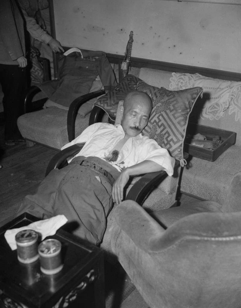With a gaping bullet wound just below the heart, Gen. Hideki Tojo, former Japanese premier who failed to lead Japan to victory, lies semi-conscious in a chair after he shot himself, September 11, 1945 in Tokyo, Japan. (AP Photo/Charles Gorry) Ref #: PA.8689560