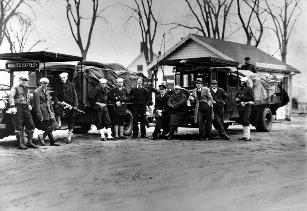 Coast guardsmen stand in front of two truck loads of liquor that were seized after a midnight battle between three Falmouth policemen and a score of alcohol smugglers in the woods near Falmouth, Ma., April 14, 1931. One policeman was injured and all the rum runners escaped. (AP Photo) Ref #: PA.8693290 Date: 14/04/1931