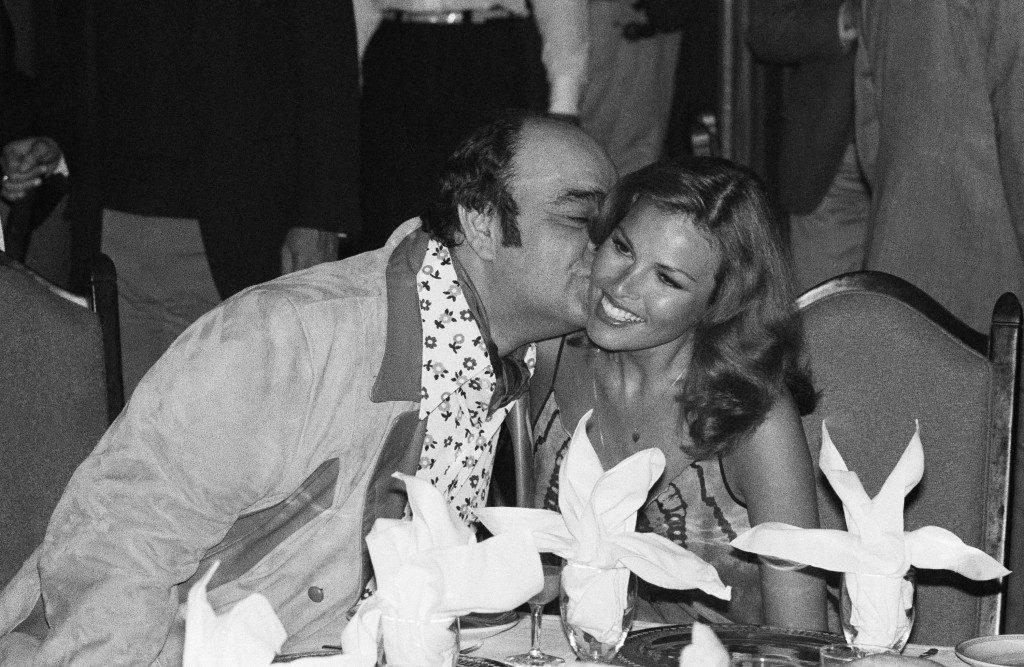 "Actor James Coco plants a kiss on the cheek of actress Raquel Welch at a party in New York, Monday, May 12, 1975 given by Bombay producer Ismial Merchant, who produced ""the wild party,"" in which Coco and Miss Welch co-star. (AP Photo/Ray Stubblebine) Ref #: PA.8722527  Date: 12/05/1975"