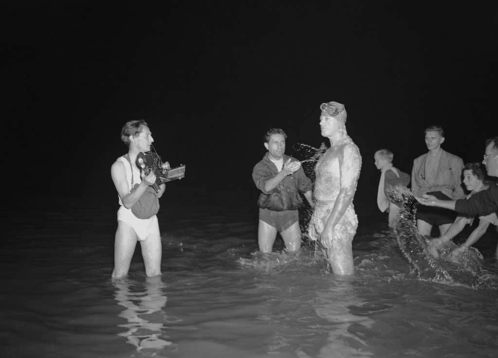 Associated Press staff photographer Jean-Jacques Levy, left, wears swimming trunks while covering the departure of Fernand du Moulin, Belgian who swam the English channel from Cap Gris Nez to Dover, Sept. 8, 1949. Levy was later joined by photographer-Editor Michael Nash in covering the channel attempt of Shirley May France. (AP Photo) Ref #: PA.8733172  Date: 08/09/1949