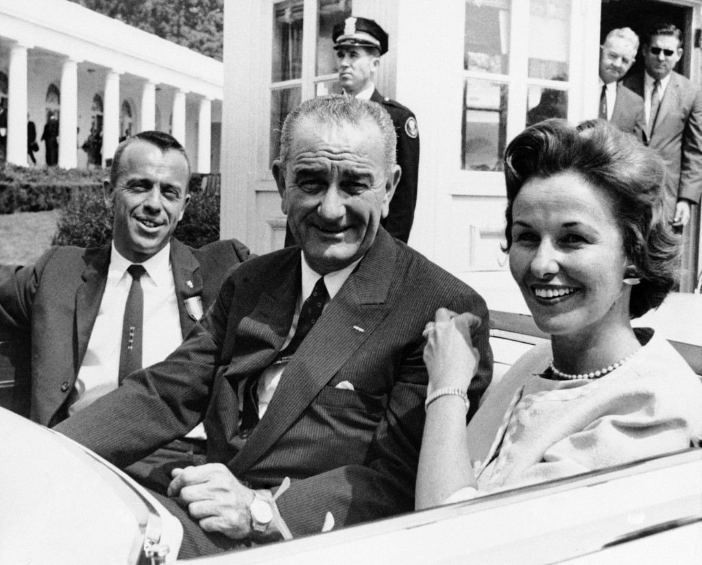 Navy Cmdr. Alan Shepard and his wife pose with Vice President Lyndon Johnson as they leave the White House for the Capitol in Washington on May 8, 1961. Approximately 250,000 persons lined downtown Washington streets to pay tribute to Shepard, first American to make a space flight. At the Capitol, Shepard and other astronauts were greeted by members of Congress. (AP Photo) Ref #: PA.8776607