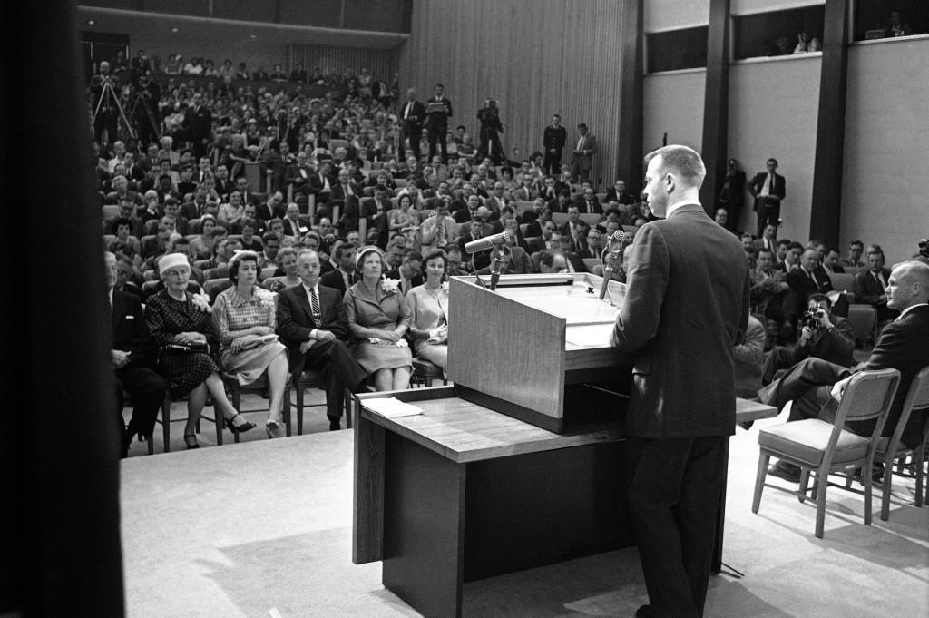 America's first spaceman, Navy Comdr. Alan Shepard, appears in a crowded state Department auditorium at news conference on May 8, 1961. Sitting in the front row, from left, are: Mr. and Mrs. R. P. Brewer, parents of Mrs. Shepard; Col. and Mrs. Gordon Sherman, sister of Astronaut Shepard; Col. and Mrs. Alan Shepard, Sr., and Mrs.Louise Shepard, wife of the Astronaut. (AP Photo) Ref #: PA.8776615
