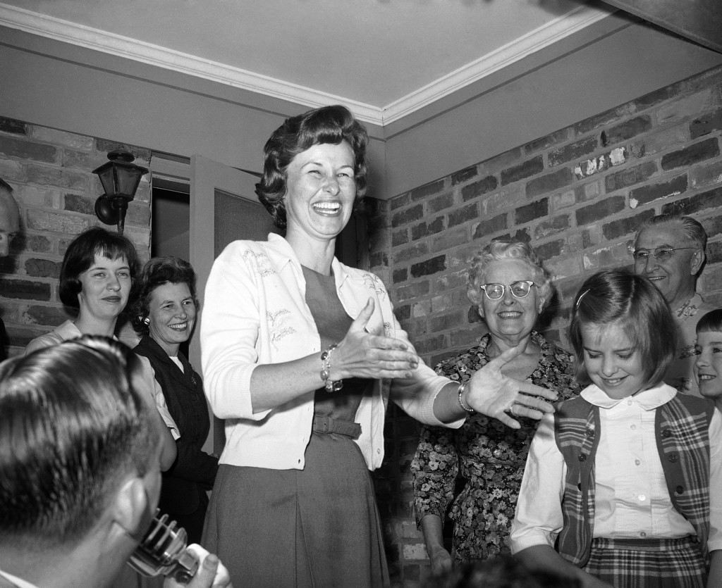 Almost beside herself with glee, Mrs. Alan Shepard, left, wife of famous astronaut, as she appeared on the front porch of her Virginia Beach home after the word had come that her husband was safe. With her are her mother and father, Mr. and Mrs. Russell Brewer, Alice Williams, a niece and her daughter Juliana in Norfolk on May 5, 1961. (AP Photo/Bill Allen) Ref #: PA.8776619