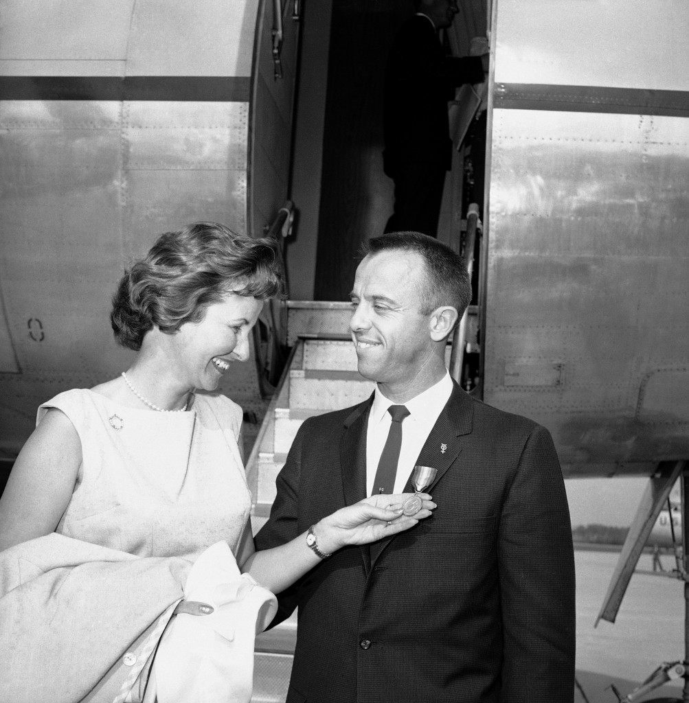 Mrs. Louise Shepard, wife of the first U.S. astronaut to make a space flight,Alan Shepard admires the NASA Distinguished Service Medal given Shepard by President Kennedy as Washington honored the spaceman. The couple poses at foot of ramp to plane at Andrews Air Force Base, Md. on May 8, 1961 taking them to Kangley Field, Virginia. (AP Photo/Paul Vathis) Ref #: PA.8776626