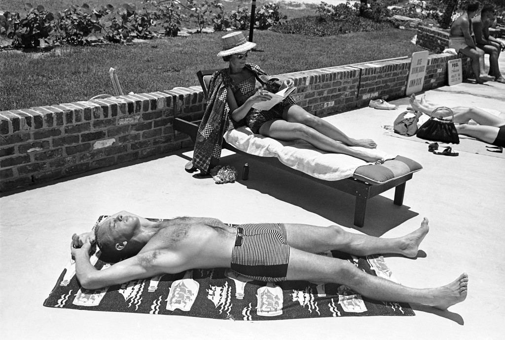 Astronaut Alan B. Shepard Jr., the first American to make a space flight, relaxes beside a pool at a Cocoa Beach Hotel in Cape Canaveral, Florida on July 16, 1961. Mrs. Louise Shepard reads a book in the background. This week a second astronaut will duplicate Shepard's feat by making a suborbital flight from Cape Canaveral aboard a Mercury spacecraft atop a Redstone rocket. (AP Photo/Murray Becker Ref #: PA.8776659