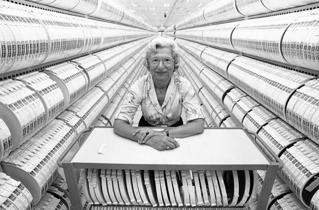 Lillie Steinhorn, 74, stands inside the computer tape storage room at the headquarters of the Social Security Administration in Baltimore, Aug. 12, 1985. She began work for the agency in 1936, a year after the Social Security Act was signed into law. The SSA administration is replacing these tapes with more modern, direct access storage devices that take up less room. (AP Photo/Bill Smith)