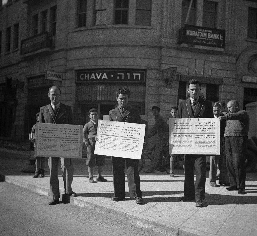 """Save our children and our parents!"" say these Jewish placards carried by men in the streets of Jerusalem, Israel on Jan. 16, 1939. ""Open the gates of Palestine to the times of Nazi prevention hatred at the Christmas period we are crying from the holy city of Jew Salem to all Christian nations to help us against ""Germany"". (AP Photo) Ref #: PA.8988884 Date: 16/01/1939"