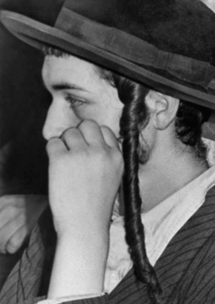 Orthodox Jews listen intently as they attend a United Nations Special Committee on Palestine hearing in Jerusalem, July 16, 1947. Seldom photographed because of their religion the Jews' appearance is marked by the long curls extending down their cheek in accordance with their religious beliefs. (AP Photo/James Pringle) Ref #: PA.8996279 Date: 16/07/1947