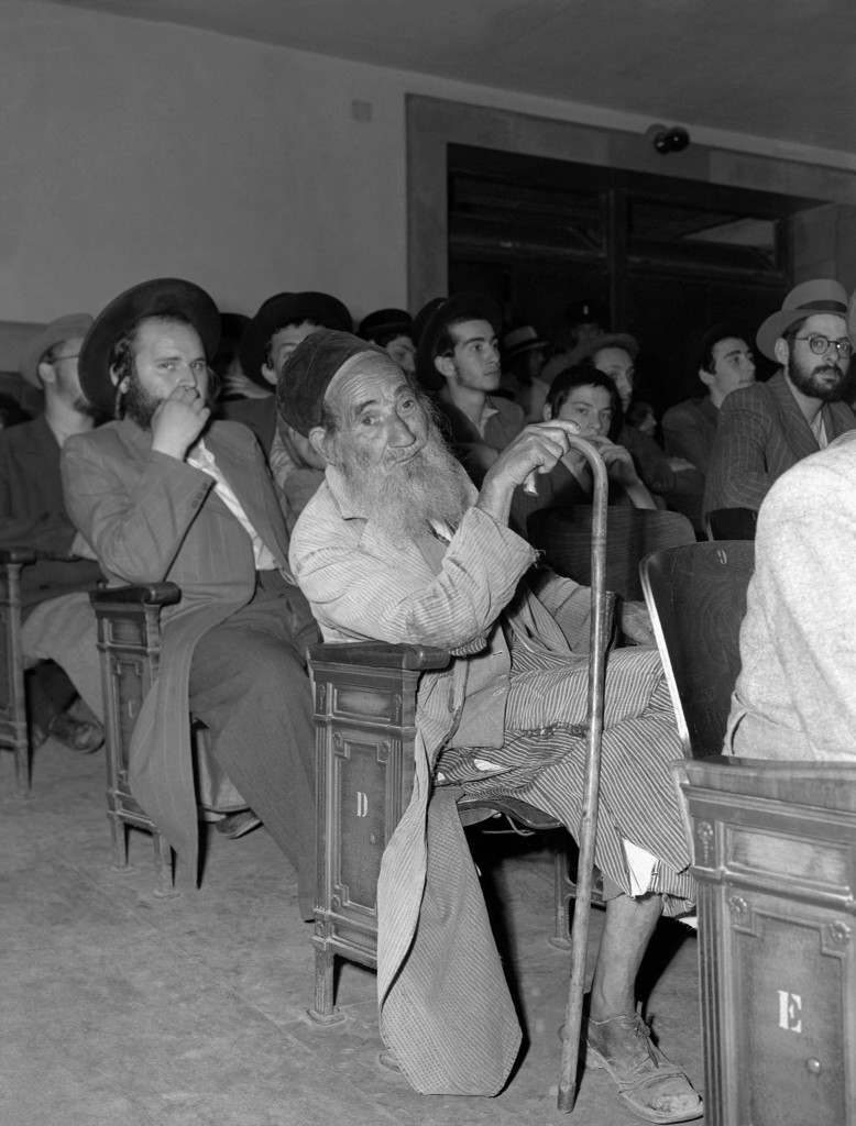 An unidentified Orthodox Jew, wrinkled with age, wearing a long beard, tattered robes and cane, attends a session of the United Nations Special Committee on Palestine in Jerusalem, June 16, 1947, to hear Joseph Zvi Dushinski, Chief Rabbi of Agudath Israel Congregation in Palestine, speak on behalf of his group. (AP Photo/James Pringle) Ref #: PA.8996280 Date: 16/07/1947