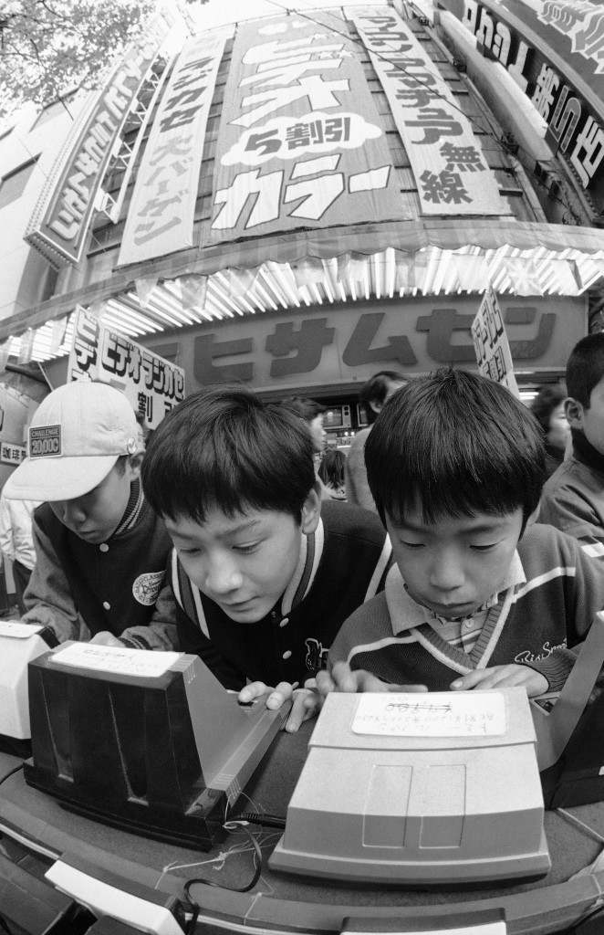 Japanese youngsters master electronic games at Akihabara in Tokyo's high-tech shopping center, May 17, 1983. The stereo stores and computer shops draw tens of thousands of marveling Japanese daily. In the 1980s, as the world stands on the threshold of a technological future, it seems likely that the Japanese, through team effort and hard work, will probably dominate. (AP Photo/Neal Ulevich)