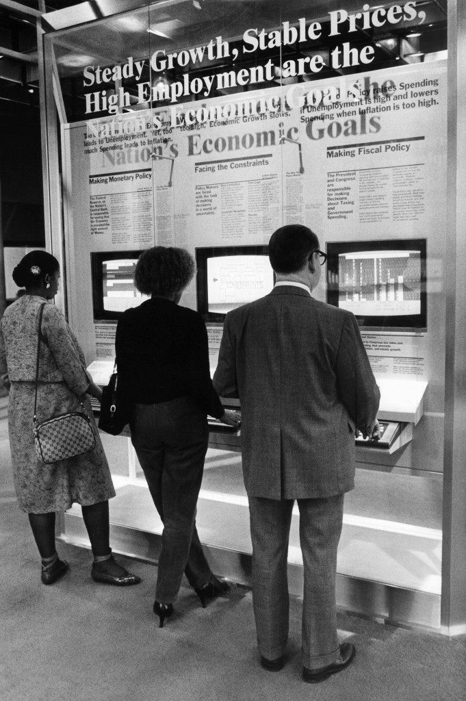 Video games, Federal Reserve style, are the center of attention at the San Francisco bank with the opening of a $2 million exhibit of cartoons, photographs, talking computer games and push button graphics on Feb. 17, 1983. It's all designed to explain economic mysteries like supply and demand and governmentÂ's role in the economy. (AP Photo/Sal Veder)