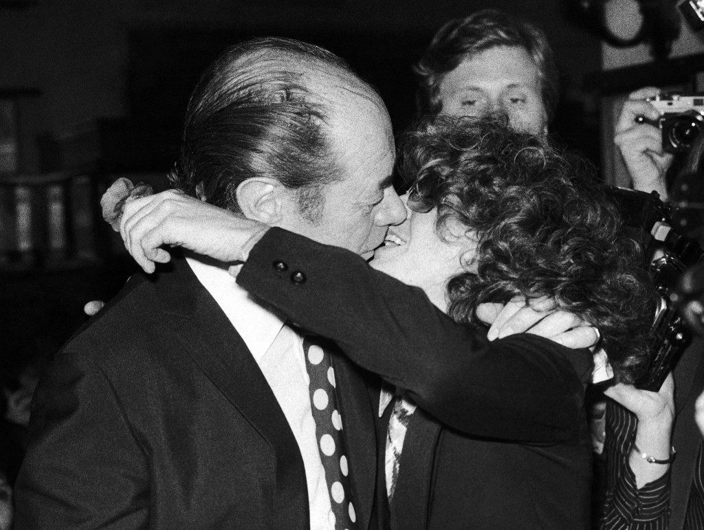 "British actor Rex Harrison and his costar in revival of George Bernard Shaw's ""Caesar and Cleopatra,"" Elizabeth Ashley, kiss during a party at a New York, United States, restaurant on Thursday, Feb. 24, 1977. Party was held following opening night performance of the play. (AP Photo/CRP) Ref #: PA.9212728  Date: 24/02/1977"