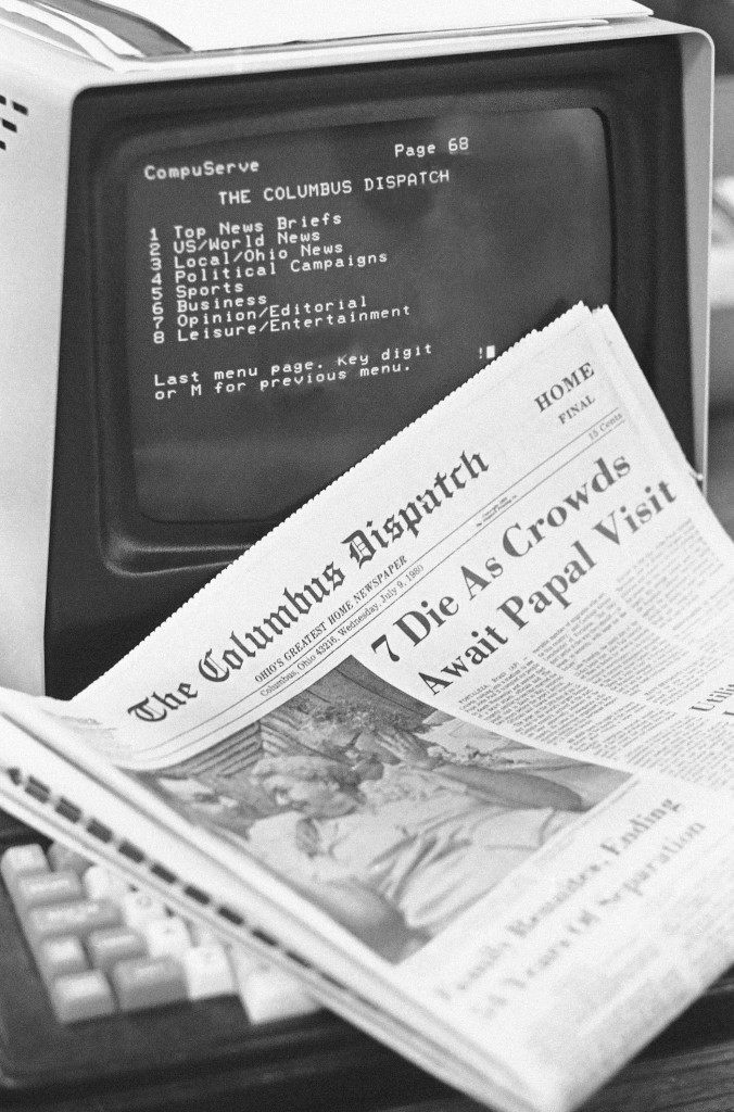 A copy of the Columbus Dispatch and a computer terminal listing the index for Dispatch and Associated Press stories which can be viewed through the CompuServe system in Columbus, Ohio on July 9, 1980. (AP Photo)
