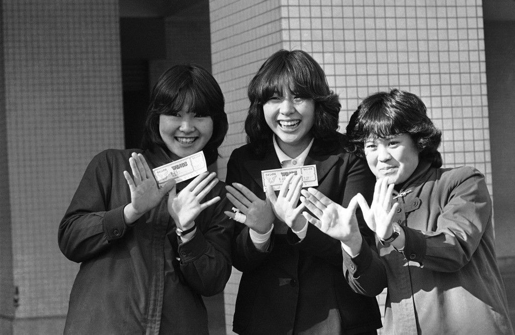 "Japanese teenage girls in high school uniform shown making their hands look like a shape of ""Wings"", British rock group, whose leader is in trouble as they waited patiently outside the Tokyo District Public Prosecutor's Office in hope to take a glance at their super star Paul McCartney on Jan. 18, 1980. McCartney was questioned at the office for marijuana possession. The unidentified fans with the useless tickets for a Wings' concert, for which they paid about $20 each, said they love Paul and Wings but don't know about Beatles. (AP Photo/Katsumi Kasahara) Ref #: PA.9322587"