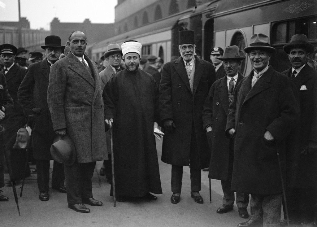 The Grand Mufti of Jerusalem, white head wear and Musa Kazim Pasha El Husseini, center right, aged 82 photographed on arrival at Victoria Station in London on March 30, 1930. The delegation is in Britain to urge, among other things, the establishment of a Palestinian National Democratic Government in which both Arabs and Jews will participate in proportion to their numbers. The delegation is headed by Musa Kazim Pasha El Husseini in accordance with Arab custom of giving the precedence to age. (AP Photo) Ref #: PA.9431308 Date: 30/03/1930