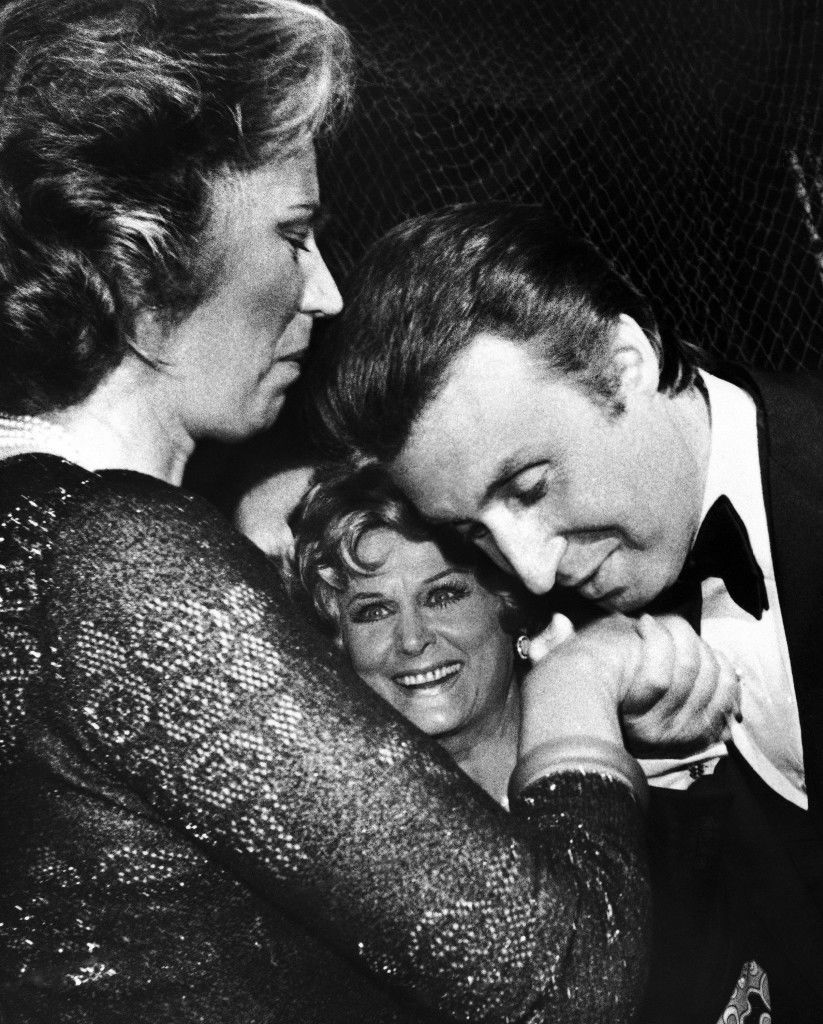 "Austrian actor and singer Peter Alexander, bows to give a kiss on the hand of Mildred Scheel, wife of the German president and chairwoman of the German Cancer Aid, on June 15, 1975 in Cologne, Germany, during the gala show ""Treffpunkt Herz"" ( Meeting place Heart), while Hungarian singer actress and dancer Marika Roekk looks on. Ref #: PA.9500099  Date: 15/06/1975"