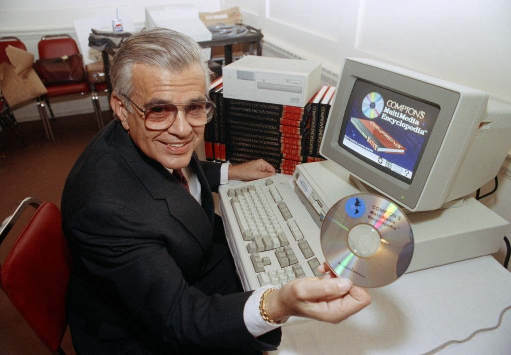 """Stanley Frank, President of Britannica Software of San Francisco holds a new 5"""" compact disc containing 26 volumes of Compton's Encyclopedia in New York Tuesday, Sept. 20, 1989. The """"talking"""" encyclopedia is intended for schools teaching students from the fourth through the eighth grades. (AP Photo/Richard Drew) Ref #: PA.9529859"""