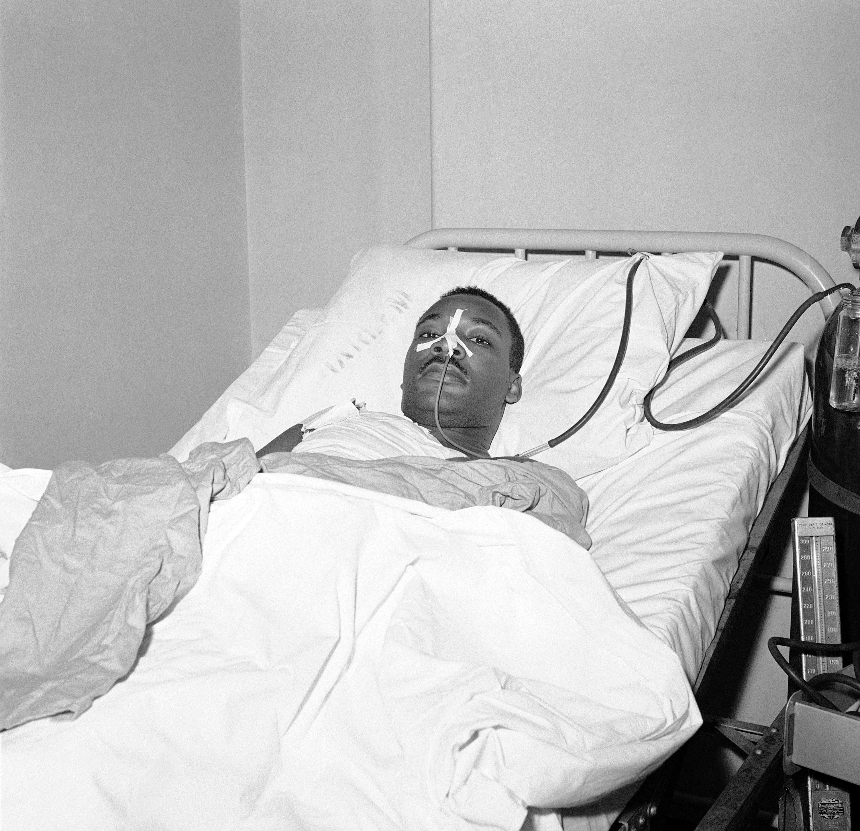 The Rev. Martin Luther King Jr., African American integration leader, in bed