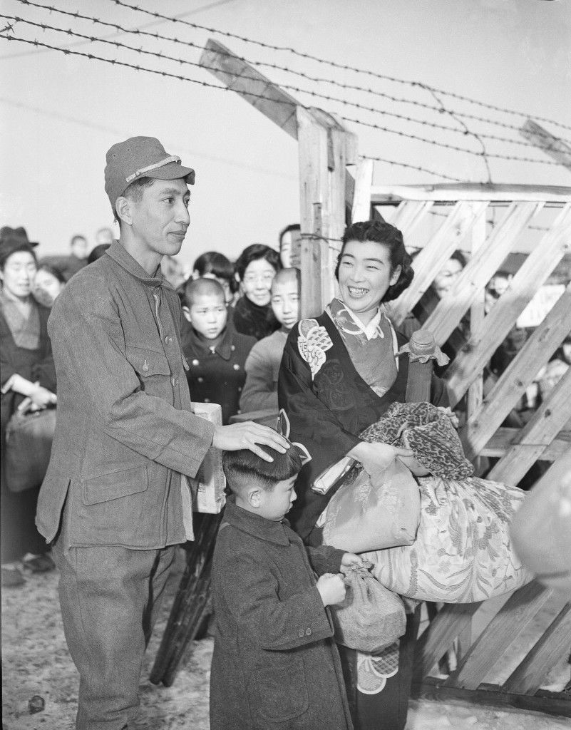 This is one of the 46 men who were released by the army in Tokyo, as part of SCAP's plan to free men who have served over 3 years and have good behavior records, this former Japanese POW guard as he walked out of the gates of Sugamo prison with his wife and young son in Tokyo, Dec. 30, 1949. (AP Photo) Ref #: PA.9536723