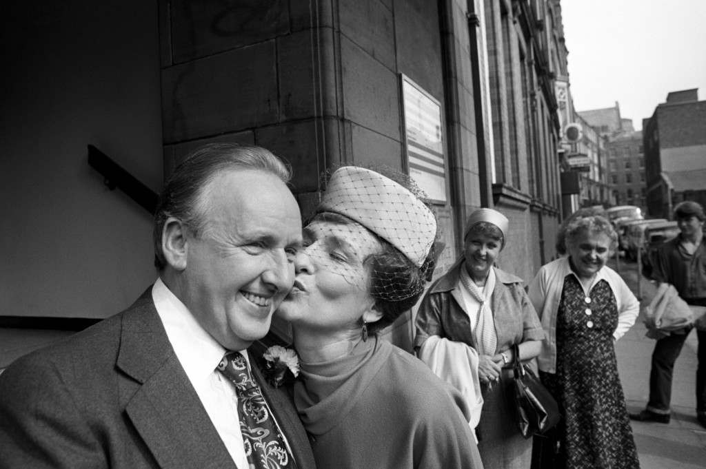 Coronation Street's Emily Bishop, played by actress Eileen Derbyshire, outside Manchester Registry Office after the TV wedding with screen husband Arnold Swain, played by George Waring. Ref #: PA.9622039  Date: 26/08/1980