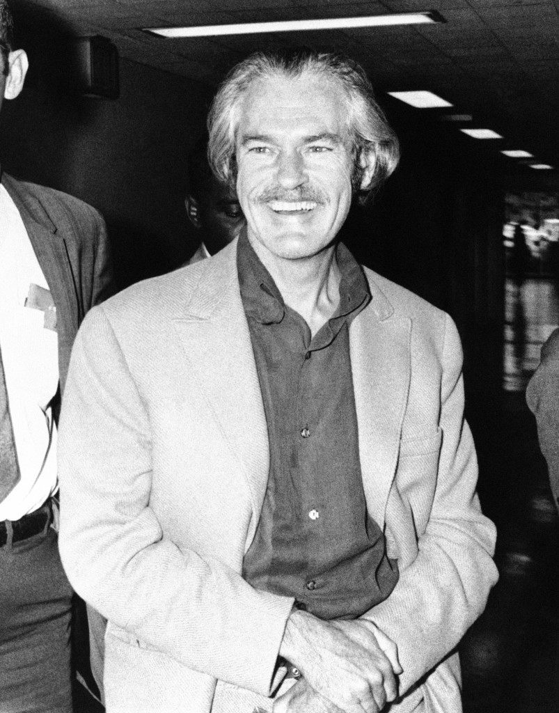 This is a 1970 photo of Dr. Timothy Leary, in custody of federal marshals as he leaves the Federal Building in Houston, Jan. 16, 1973 after being sentenced to 10 years in prison on marijuana charges. (AP Photo) Ref #: PA.9789472