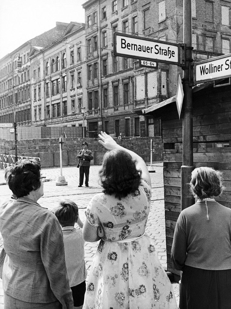 Wall anniversary: Thousands of armed men stood guard on both sides of the Berlin wall, Germany, on August 13, 1962, the first anniversary of the day the communists started building it. Both sides were set to prevent an emotional build-up that could lead to dangerous incidents. Here at Bernauer Strasse, West Berliners wave to relatives in East Berlin. (AP Photo/Werner Kreusch) Wall anniversary: Thousands of armed men stood guard on both sides of the Berlin wall, Germany, on August 13, 1962, the first anniversary of the day the communists started building it. Both sides were set to prevent an emotional build-up that could lead to dangerous incidents. Here at Bernauer Strasse, West Berliners wave to relatives in East Berlin. (AP Photo/Werner Kreusch)