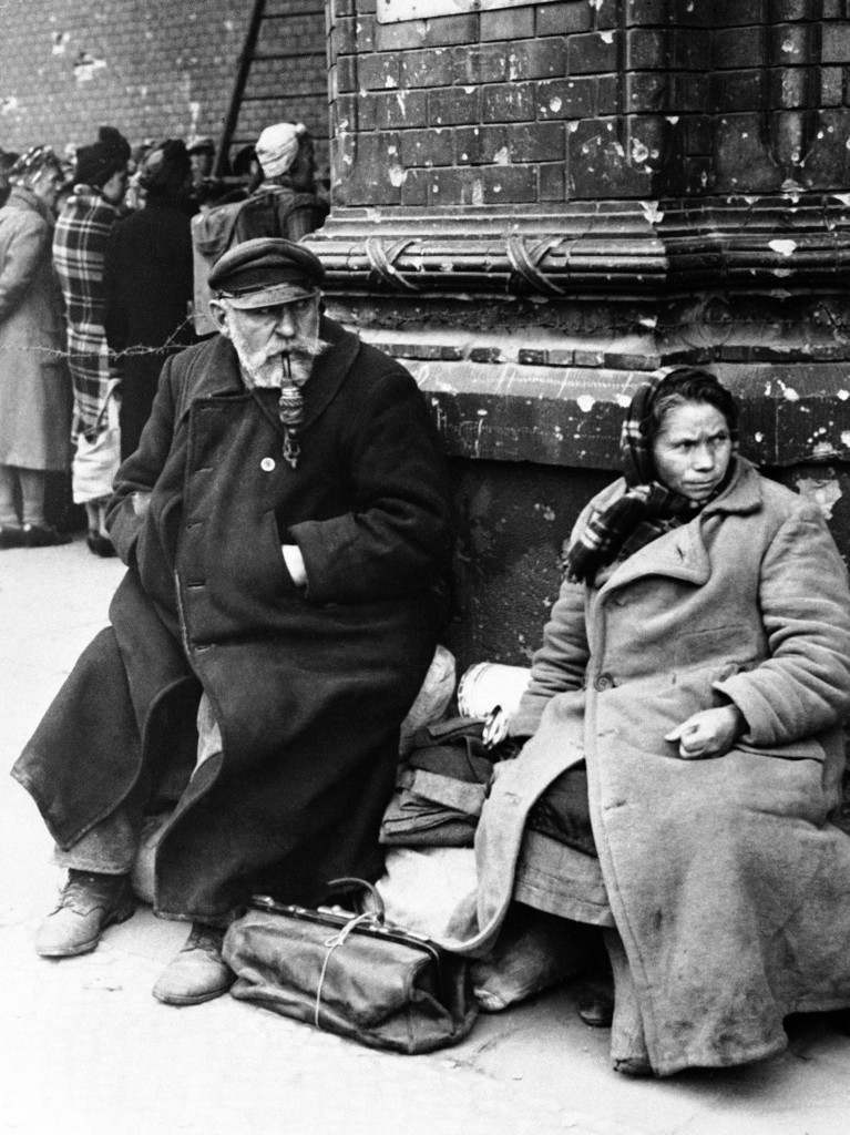 The removal of displaced persons is one of the many unsolved problems in Berlin. Hundreds of these displaced persons crowded the Anhalter Bahnhof station in Berlin for a train to Wittenberg, Germany, en route home. Many of them had waited as long as two days for transport, and those who did not get on the train had to wait another day for the next one. A study of two aged German displaced persons who waited with their baggage's outside the Anhalter Bahnhof Station, in Berlin, on Oct. 11, 1945, for the train to Wittenberg. (AP Photo) Ref #: PA.9878252  Date: 11/10/1945