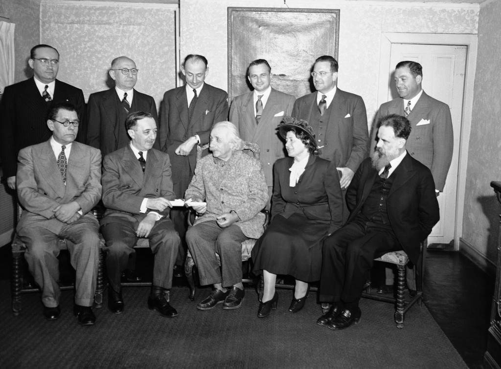 Prof. Albert Einstein receiving honorary PhD from Hebrew University of Jerusalem at his home 112 Mercer St., Princeton, New Jersey, on March 15, 1949, through the American Friends of the Hebrew University. Group at the presentation, left to right, seated: Prof. Eleazar L. Sukenik of Hebrew Univ.; Dr. Israel S. Wechsler, Pres., Amer. Friends of Hebrew Univ.; Prof. Albert Einstein; Mrs. Tamar De Sala Pool, past president, Hadassah; Leo A. Mayer. Standing: George Wise, Mark Sugarman, Prof. Gershon Scholen, High Salpeter, Sylvan Gotschal and Joseph Mazer. (AP Photo/Alan Richards) Ref #: PA.9903148 Date: 15/03/1949