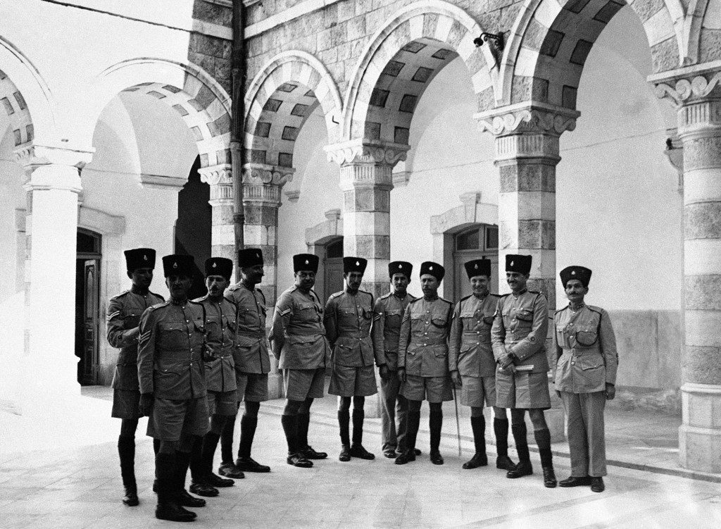 Young Arab recruits and volunteers from the British army are now undergoing intensive training at the Palestine Police Barracks in Jerusalem. An important part of the training for the young Arabs is with small arms and for the British, volunteers, specialized instruction in the types of weapons used by the Terrorists. A group of smartly dressed Arab members of the Palestine police, seen in the courtyard of their barracks in Jerusalem, on Nov. 15, 1945, which was formerly the palatial residence of a wealthy Jerusalem Arab. (AP Photo) Ref #: PA.9904571 Date: 15/11/1945