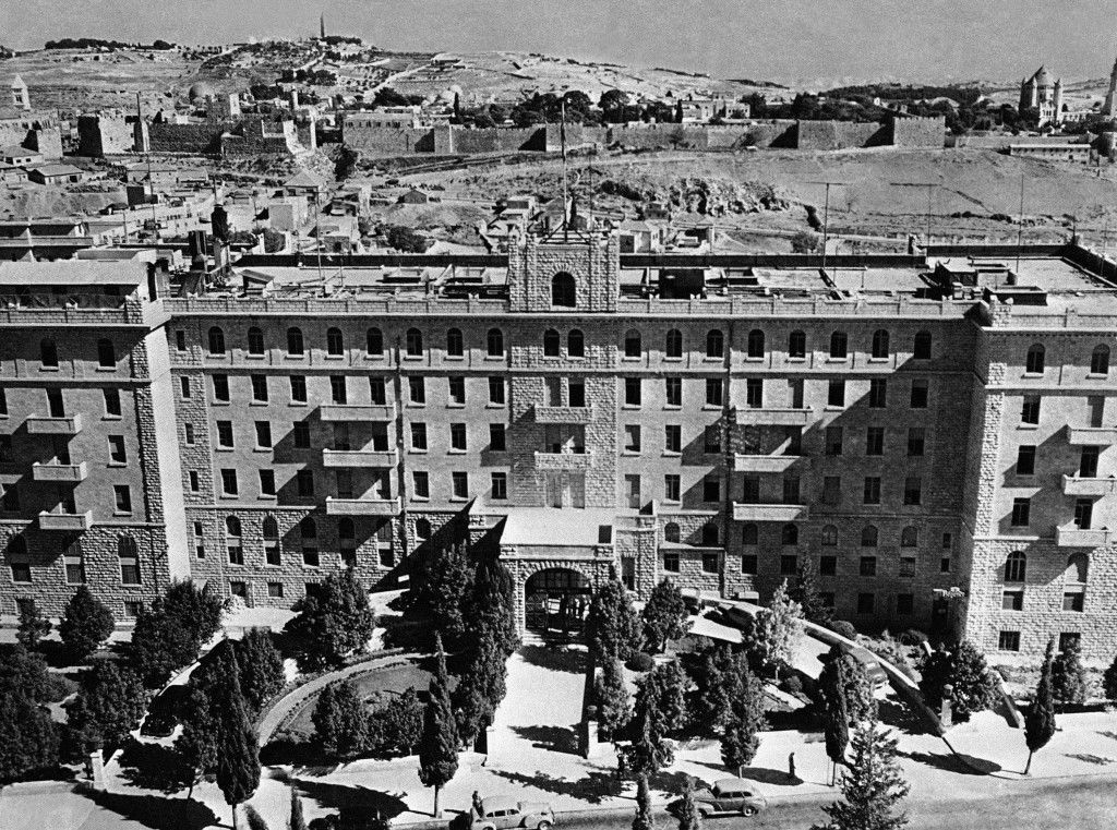 Jerusalem, Golden city of the old world, has now become an attractive city full of contrasting ancient and modern forms of architecture. The King David Hotel, Jerusalem's best, where the high military officers have their quarters. In the background can be seen the wall of the Holy City with the Mount of Olives in the distance, on Nov. 16, 1945. (AP Photo/Frank Noel) Ref #: PA.9912669 Date: 16/11/1945