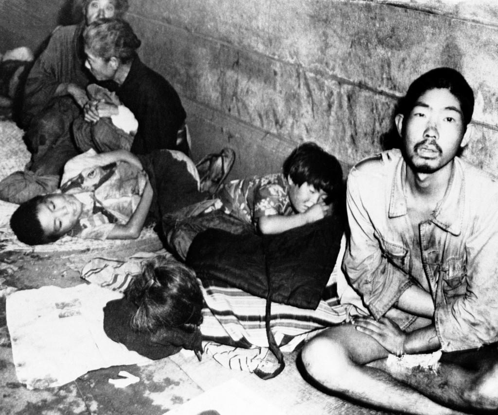 Hundreds of Japanese jam the Ueno railway station in Northeast Tokyo, on Oct. 26, 1945, these windy autumn nights seeking shelter. Homeless, the old and the young huddle together on thin matting and old newspapers, and try to sleep. Many are starving. Police estimate there are two of three deaths nightly from starvation. (AP Photo) Ref #: PA.9955783