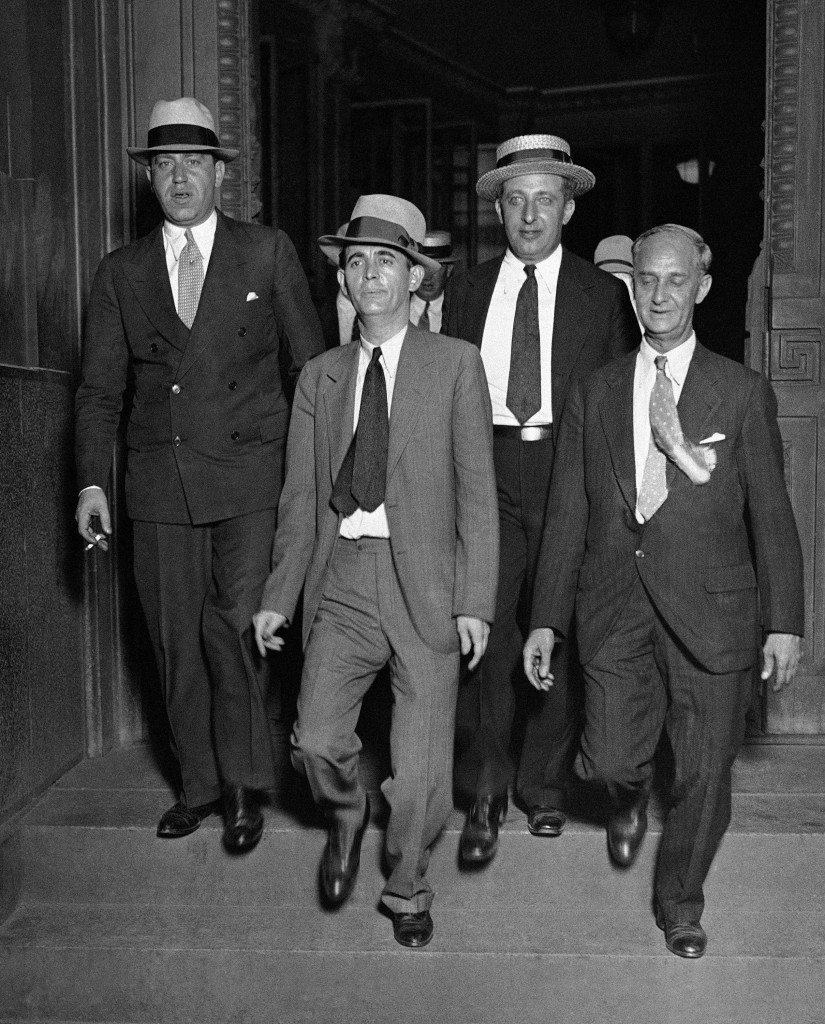 "Jack ""Legs"" Diamond, center, and his attorneys, leaving the Federal Court in New York on August 8, 1931, after his conviction of owning an unlicensed still and conspiring to violate the prohibition law. The jury deliberated slightly more than two hours before returning its verdict. Under the terms of the law Diamond is subject to maximum sentence of four years in federal prison and a combined fine of $11,000. (AP Photo) Ref #: PA.9966469  Date: 08/08/1931"
