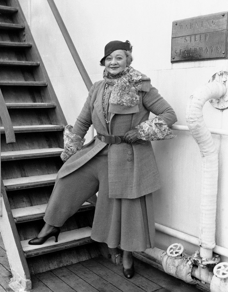 "Sophie Tucker, the comedienne, upon her arrival in New York on Sept. 9, 1931 after spending more than a year in London and Paris. Miss Tucker is dressed in what she claims is the ""latest thing"" -- afternoon pajamas of blue tweed, designed by Paul Poiret. (AP Photo) Ref #: PA.9969025  Date: 09/09/1931"
