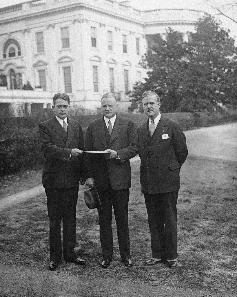 A program calling for a prohibition referendum and an additional expenditure of $25,000,000 for veterans' relief was presented to President Herbert Hoover at the White House on Dec. 8, 1931, by Harry L. Stevens, Jr., commander of the American Legion. From left to right are Stevens, President Hoover and John Thomas Taylor, legislative representative of the Legion. (AP Photo) Ref #: PA.9996645 Date: 08/12/1931