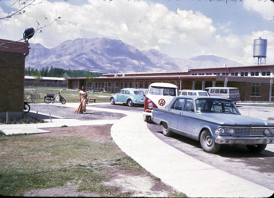 "Parking lot of the American International School of Kabul. The school no longer exists, although alumni stay in touch through Facebook and hold reunions every few years at different cities around the U.S. The next reunion will be held in Boston in 2013. ""AISK's last year was 1979, so the school had a 20 year history. AISK was located on the same campus that currently houses the American University of Afghanistan (on Darul-aman Rd in west Kabul). In 1967-68, there were about 250 students attending AISK and 18 graduating seniors."" - Peg Podlich"