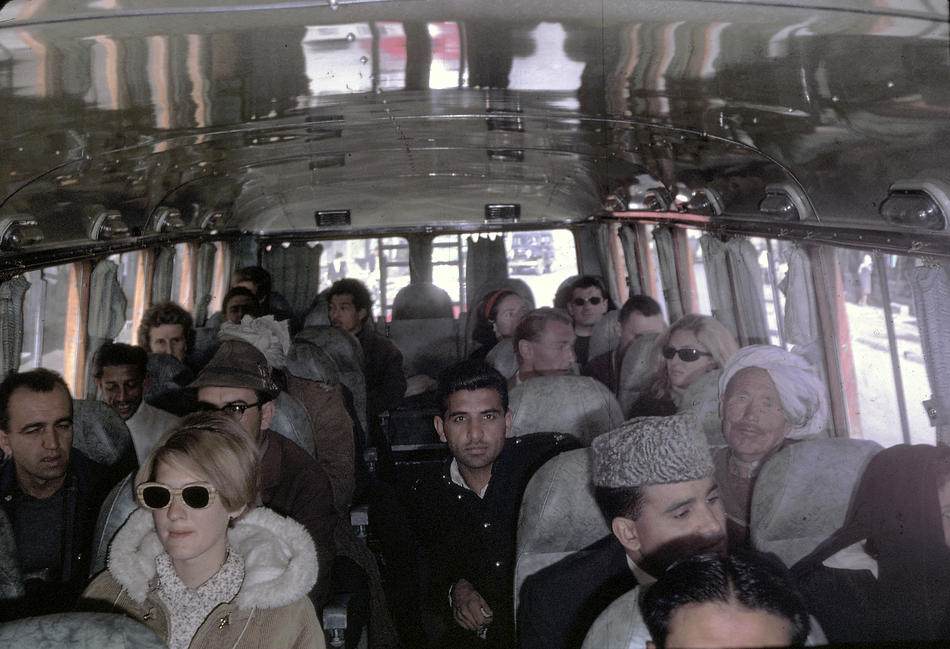 Peg Podlich, in the sun glasses, taking a family trip on a bus going from Kabul, Afghanistan to Peshawar, Pakistan.