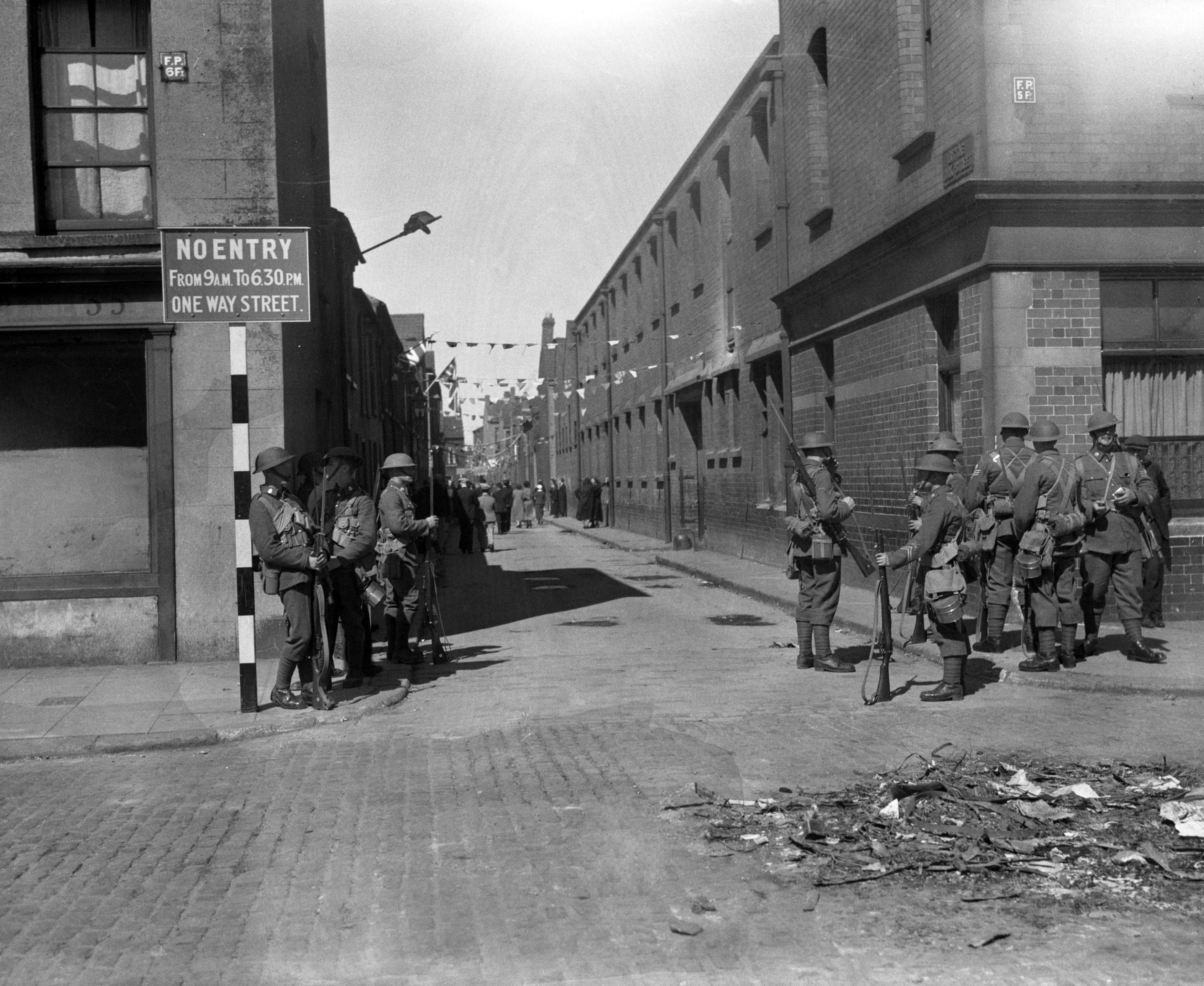 Troops were called out in Belfast, Ireland on July 13, 1935, when rioting between Unionists and Nationalists flared up again. Soldiers on guard with fixed bayonets in York Street. (AP Photo/BEAD)