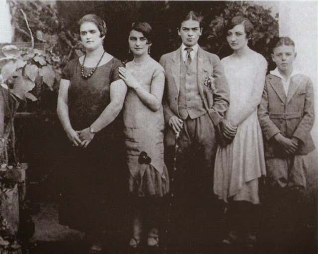Frida Kahlo in drag, with sisters Adriana and Christina and cousins Carmen and Carlos Verasa, 1926
