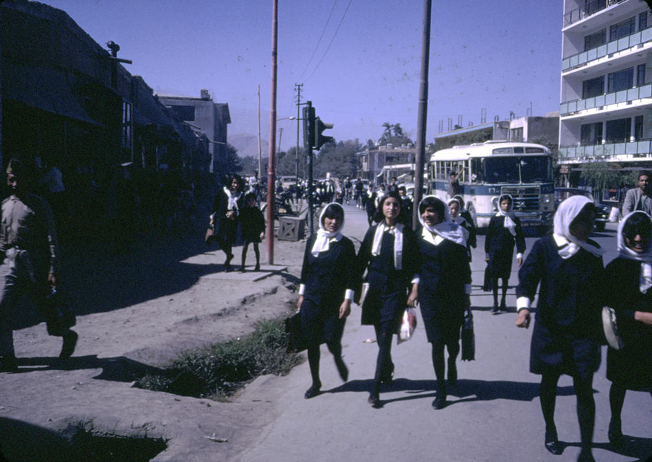 """Afghan girls coming home from school. """"Afghan girls, as well as boys, were educated up to the high school level, and although girls (and boys) wore uniforms, the girls were not allowed to wear a chadri on their way to secondary school. Able young women attended college, as did the men."""" - Peg Podlich"""