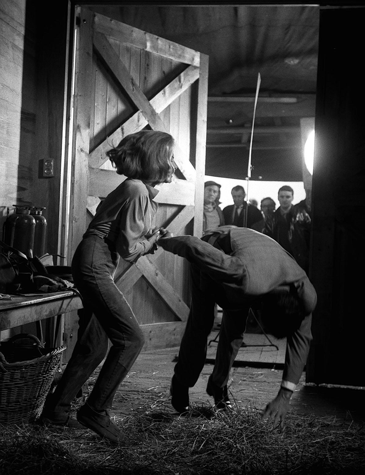 During filming of the third Bond film 'Goldfinger' at Pinewood Studios, James Bond (Sean Connery) is thrown by Pussy Galore (Honor Blackman) before romance takes over in the hayloft.