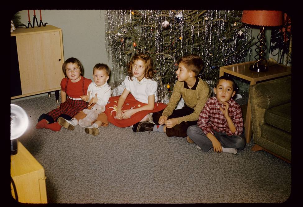Line up of kids on floor Christmas 1957
