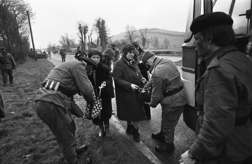 British troops search the handbags of Ulster women on the outskirts of the Northern Ireland town of Newry on Feb. 6, 1972, the day scheduled for a massive demonstration by the Pro-Catholic Civil Rights movement, to protest over the shooting of 13 civilians in Londonderry. Later the marchers avoided the town centre of Newry and held instead a peaceful protest meeting in a meadow. (AP Photo) Ref #: PA.10462311