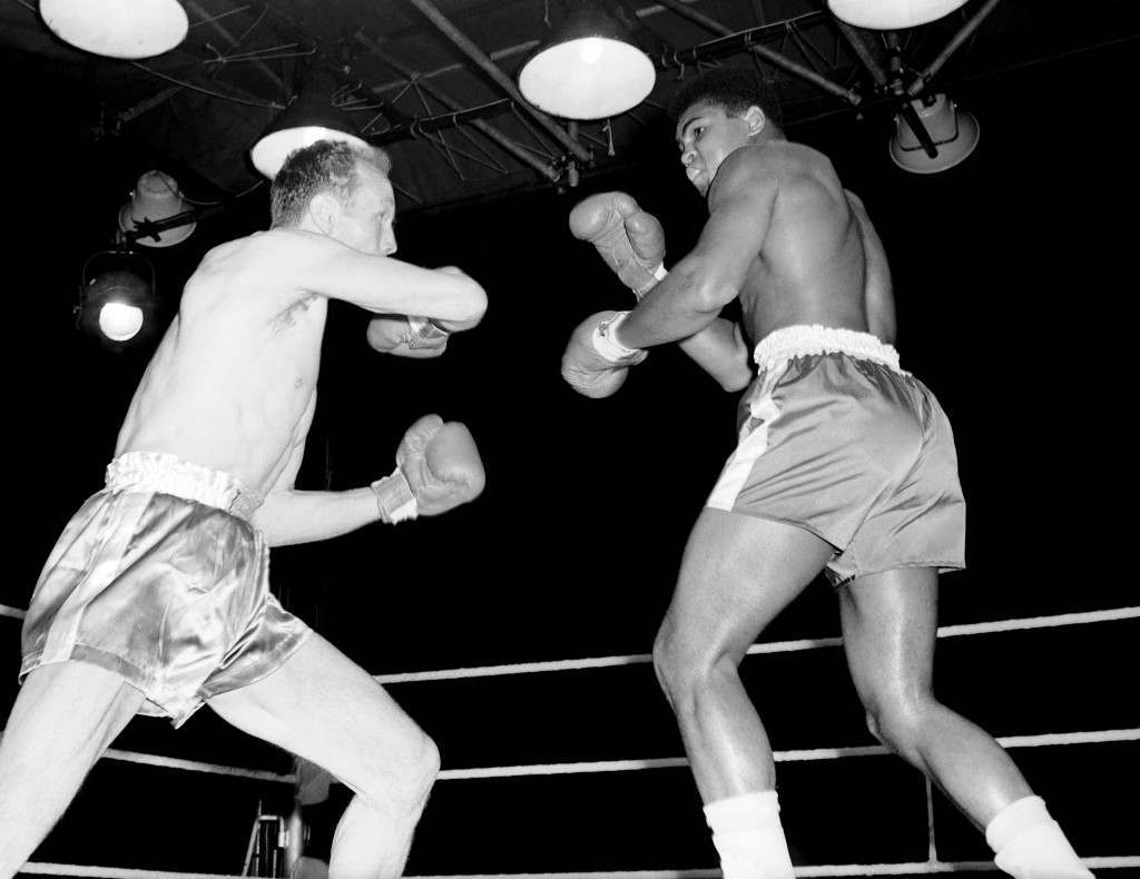 Both boxers raise their guards as they parry blows, during the heavyweight clash between American boxer Cassius Clay and the British and Commonwealth Heavyweight Champion, Henry Cooper, at Wembley Arena.