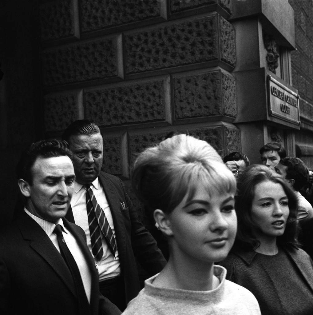PA NEWS PHOTO 22/7/63 : CHRISTINE KEELER AND MARILYN RICE-DAVIES DRIVING AWAY FROM THE OLD BAILEY, LONDON AFTER THE FIRST DAY'S HEARING IN WHICH DR. STEPHEN WARD THE 50 YEAR OLD OSTEOPATH FACES VICE CHARGES. DURING THE HEARING MR. MERVYN GRIFFITH JONES, PROSECUTING GAVE AN UNDERTAKING THAT NO ACTION WOULD BE TAKEN AGAINST HER Ref #: PA.1074556