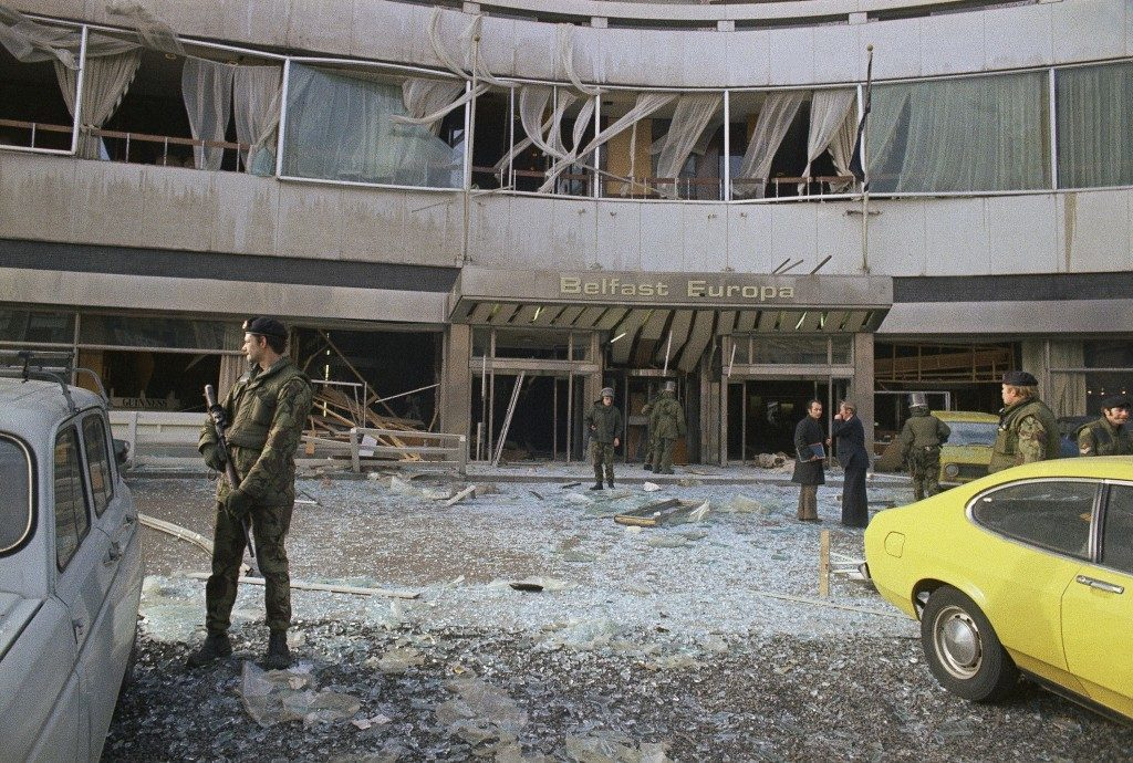 British troops stand guard as bomb experts search through the wreckage after a terrorist bomb had wrecked the ground floor on the Luxury Belfast Europa Hotel in Northern Ireland's capital in 1975. (AP Photo) Ref #: PA.10766315