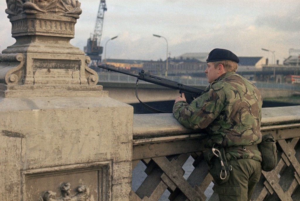 British soldier keeps vigil at a vantage point overlooking the Belfast Docks in Northern Ireland in February 1975. (AP Photo) Ref #: PA.10990786
