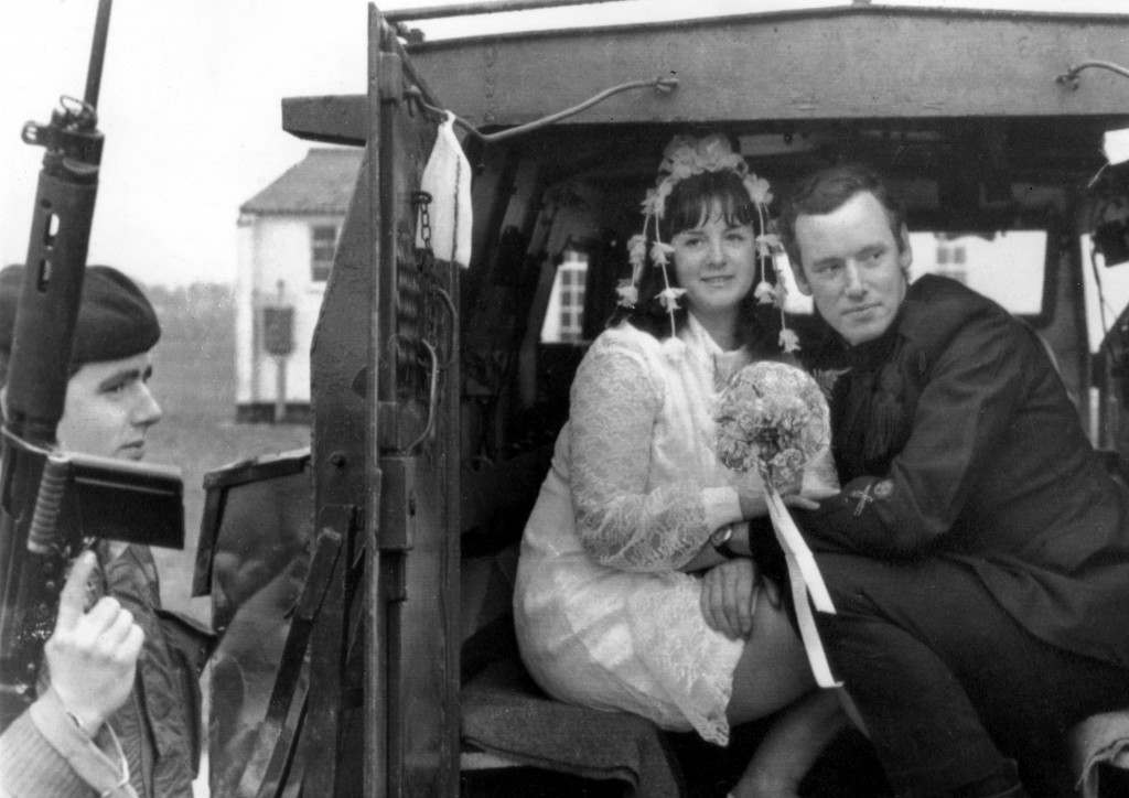 A wedding couple sitting in the back of a truck is stopped and checked by British soldiers in Shankill Road, Belfast, Northern Ireland. Ref #: PA.11024905