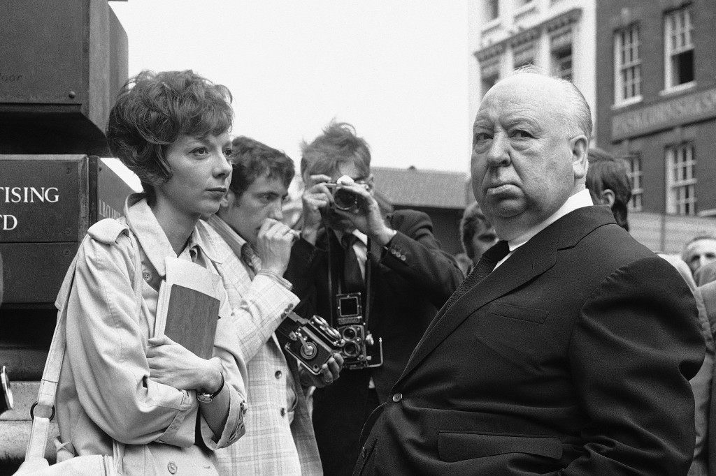 "In this July 26, 1971 file photo, British film producer and director Alfred Hitchcock, right, discusses filming with actress Anna Massey, one of the stars of ""Frenzy"", in Covent Garden Market, London.  PA.11128891"