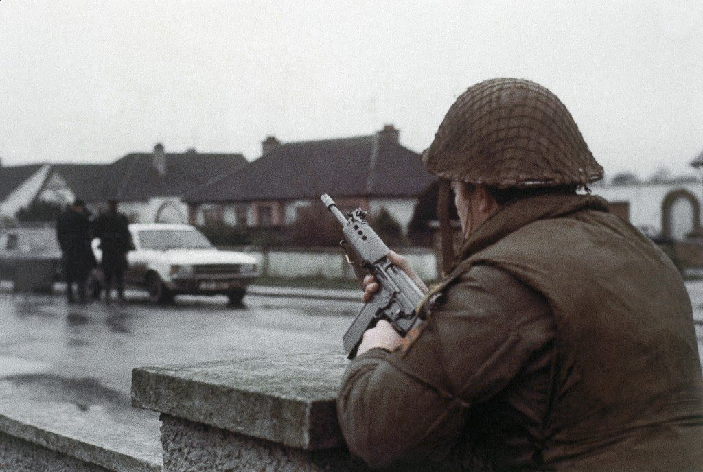 A British soldier with a rifle guards a road outside of Belfast, Northern Ireland in 1976. (AP Photo) Ref #: PA.11224982